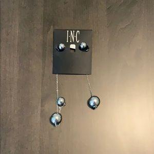 INC asymmetrical silver earrings